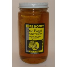 Comb 1 pound glass jar with honey